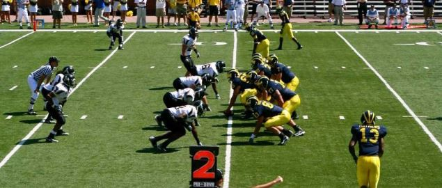 The Appalachian State Mountaineers line up against the Michigan Wolverines.