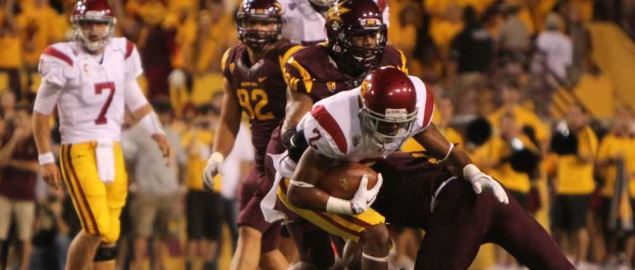 Arizona State mid field tackling USC's Robert Woods during 2011 regular season game.