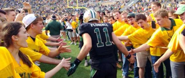 Baylor Bear quarterback Nick Florence running onto the field.