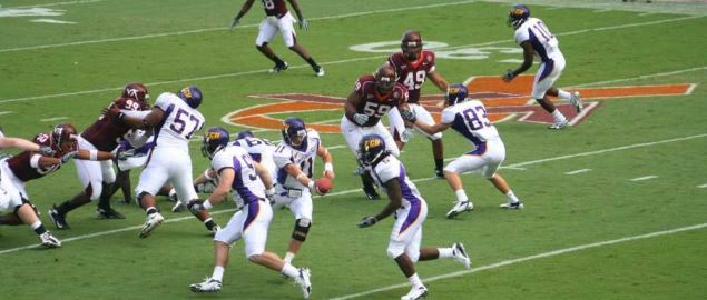 East Carolina hands off the ball vs Virginia Tech on the first play of the game, 09/01/07.