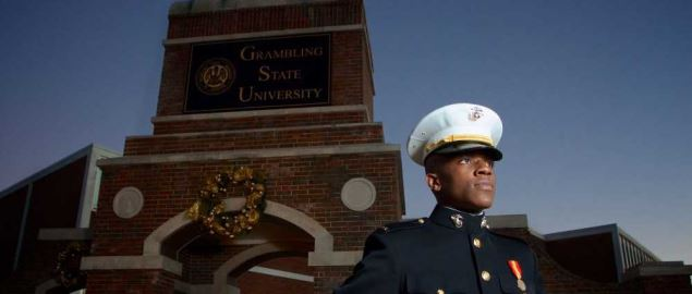 Grambling State University marine in front of school's entrance.