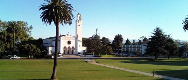 Loyola Marymount campus view of Sunken Gardens and Sacred Heart Chapel.