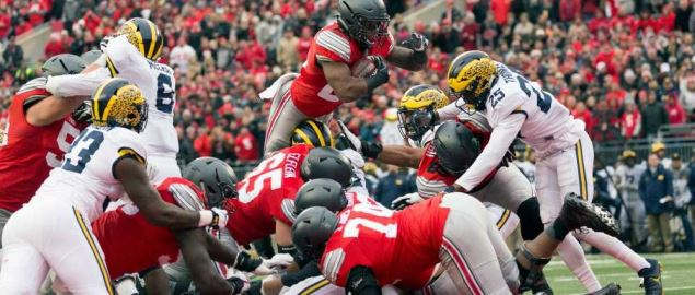 Ohio State's running back flying in to the end zone for a touchdown at home vs Michigan.