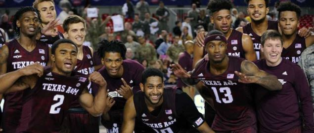 Texas A&M Aggies players pose after winning the 2017 ESPN Armed Forces Classic.