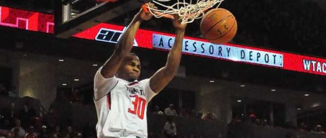 Texas Tech forward Jaye Crockett slams dunks the ball.