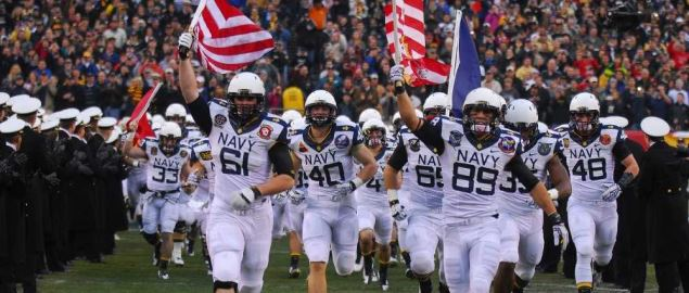 Navy Midshipmen taking the field during 113th Army-Navy game at Lincoln Financial Field.