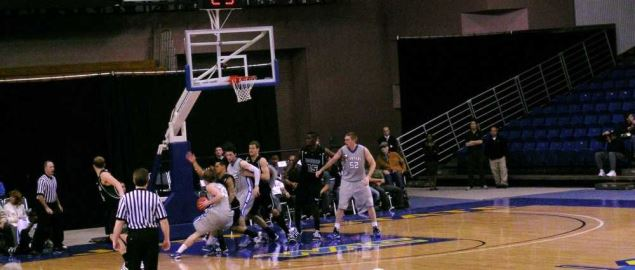 Justin Graham drives to the basket in SJSU basketball game against Hawaii.