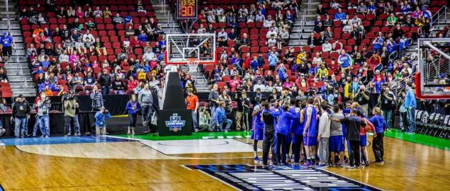 The Kansas Jayhawks huddle up at an open practice session.