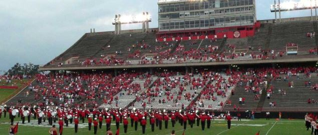 Cajun Field in Lafayette, Louisiana with the Pride of Acadiana marching band on the field.