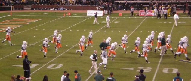 Miami Hurricanes take the field before the start of the 2008 Emerald Bowl against Cal.