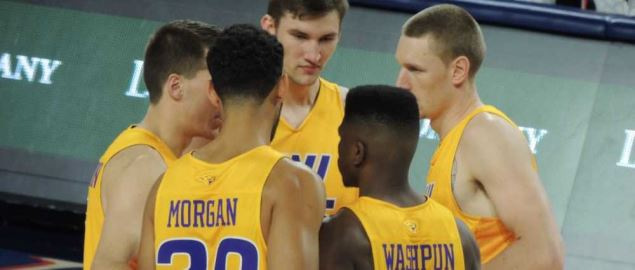 The Northern Iowa starting five huddle during a December 2015 game.