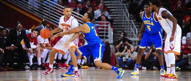 Norman Powell of UCLA Bruins defends Julian Jacobs of USC Trojans.