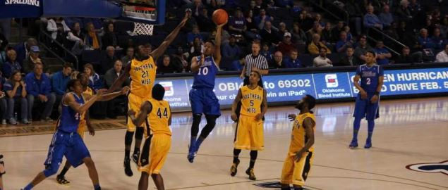 James Woodard of Tulsa shoots against Southern Miss.
