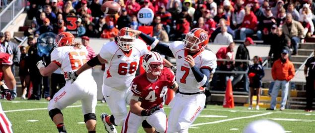 UTEP quarterback making a pass under pressure vs Wisconsin in 2012 away game.