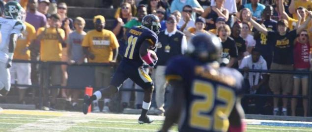 Toledo Rockets running in for touchdown vs Eastern Michigan in 2011 game.