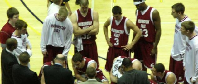 Washington State Cougars in the huddle during a road game against the Cal.